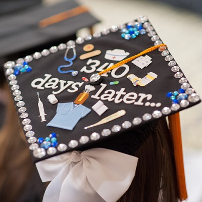 Students decorated grad cap that says 340 days later with nursing pictures